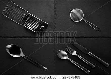 A Selection Of Kitchen Cutlery, And Other Items On Slate Tiles