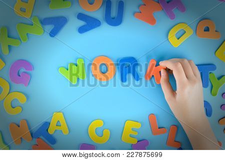 The Girl Puts Out Of The Multicolored Letters The Words Work . Beautiful Unusual Background With Vig