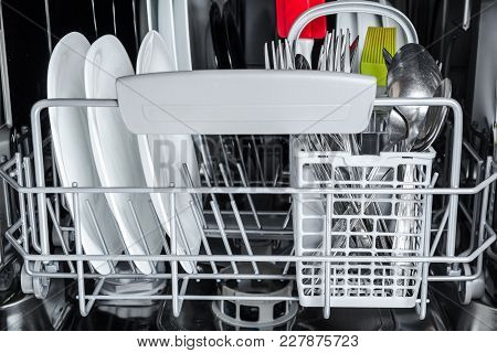 Clean Dishes In Basket After Washing In The Dishwasher