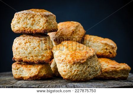 Traditional English Cheese Buns Scones On Wooden Table On Dark Background. Close-up Photo