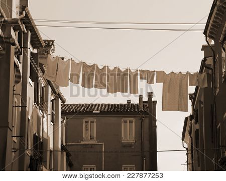 Many Hanging Clothes Out Of House Of An European City