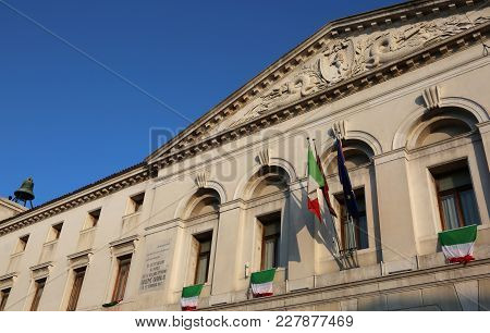 Chioggia, Ve, Italy February 11, 2018: Ancient Palace Of Town Hall With Many Italian Flags