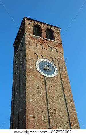 High Clock Bell Tower In Downtown Of Chioggia Island Near Venice In Italy
