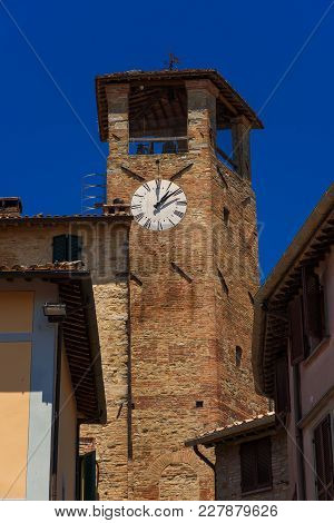 Medieval Clocktower In The Historic Center Of Montone, A Small Town In The Umbria Countryside In Ita