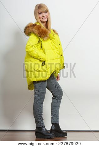 Beautiful Smiling Young Fashionable Girl Wearing Jacket With Hood. Fashion In Winter Time.