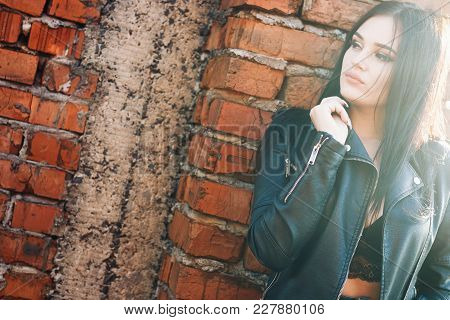 Urban Portrait Pretty Girl In Bra Leather Jacket With Beautiful Makeup. Lifestyle Portrait Lady. Hip