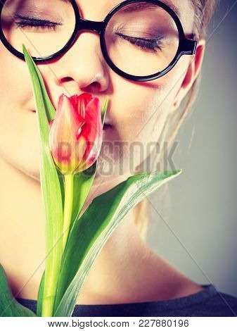 Enjoying Leisure Casual Flora Fashion Feminine Beauty Concept. Lovely Girl Smelling Flower. Young Ha