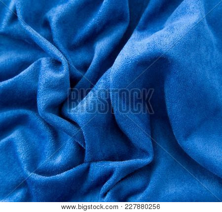 Blue Fabric As A Background . Photo Of An Abstract Texture