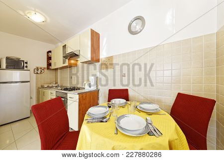 Kitchen Interior With Dining Table And Cutlery
