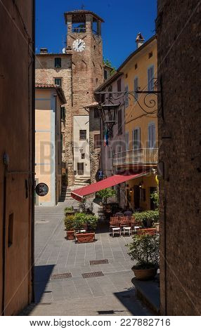 Montone, Italy - June 22: Fortebraccio Square With Old Clocktower Senn From Narrow Lane In The Histo