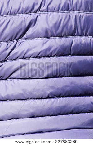 Blue Jacket Fabric As Background . Photo Of An Abstract Texture