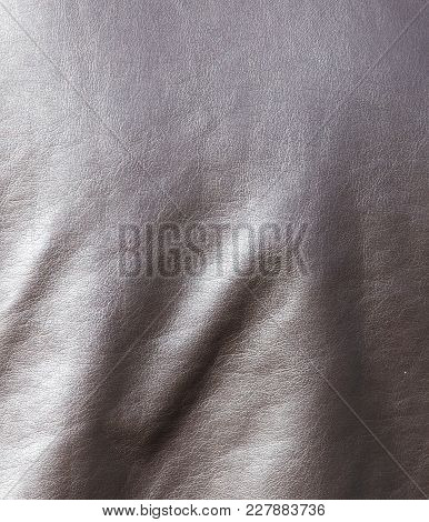 Leather Jacket As A Background . Photo Of An Abstract Texture