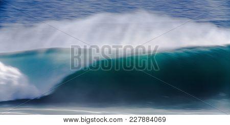 Long Exposure Image Of Blue Ocean Big Mavericks Wave In California, Usa.