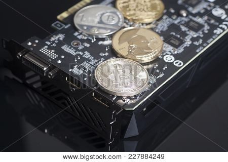 Cryptocurrency Mining Concept With Bitcoins On A Graphic Videocard On Black Background.