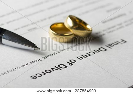 Divorce Decree Form With Marriage Ring And Pen.