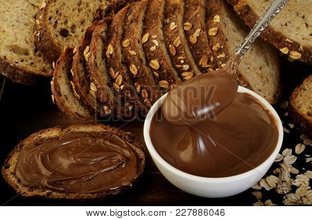 Chocolate Hazelnut Spread In Spoon At Background