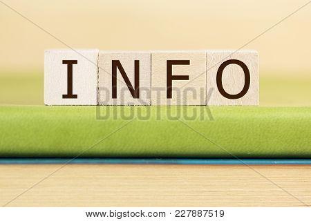 Info Written In Wooden Cubes On A Green Book