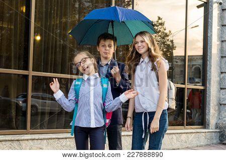 Outdoor Portrait Of A Group Of Teenage School Children.