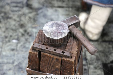The Special Table From Wooden Bars Is Fastened By A Big Bracket And An Anvil To A Hammer For Forge