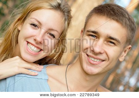 Smiling young couple at the park