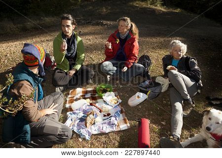 Los Ports Mountains, Spain-november 12, 2017: Group Of Friends Making A Picnic On The Mountain After