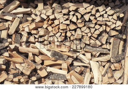 Stack Of Firewood. Texture Wood For The Fire