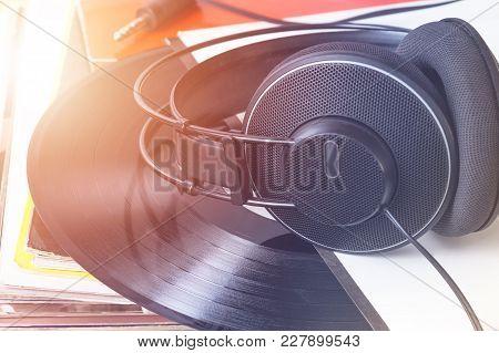 Studio Headphones On The Stack Of Vinyl Records