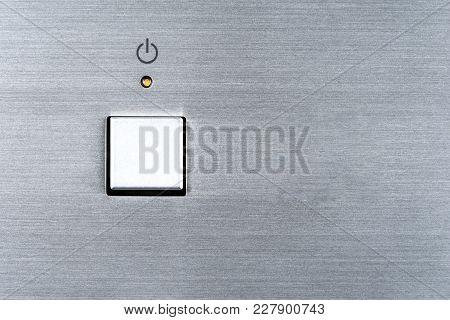 On Off Switch Button And Orange Led Lamp On Aluminium Panel