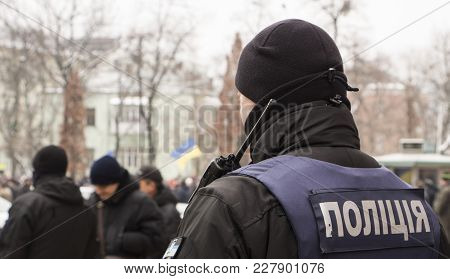 Ukrainian Police In Armor. The Inscription On The Back Police In Ukrainian