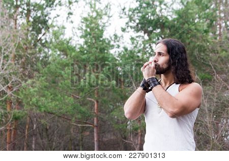Young Man Plays The Harmonica Alone Outdoor Travel Lifestyle Concept With Lake.