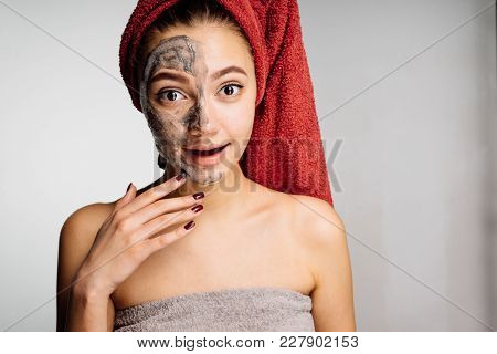 A Woolly Surprised Girl With A Towel On Her Head Applied A Useful Mask To Half The Face, Spa Procedu