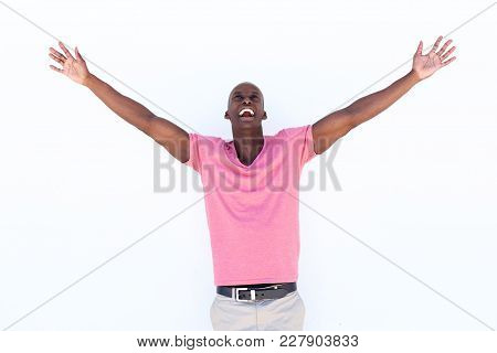 Cheerful African American Man Laughing With Arms Outstretched