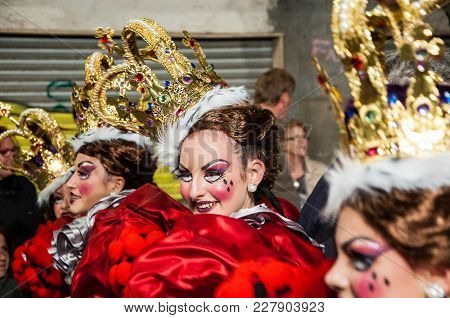 Portrait Of Young Girl At Parade Costumed Characters, Through The Streets Of The City. February 11,