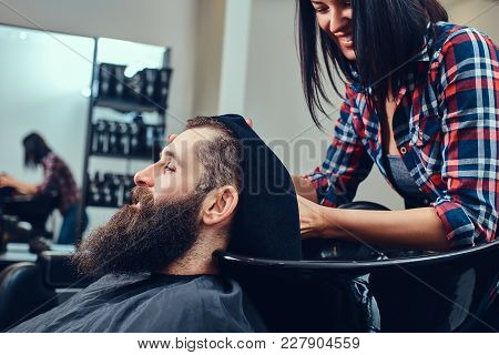 Professional Hairdresser Wiping With A Towel After Washing Head In A Barbershop.