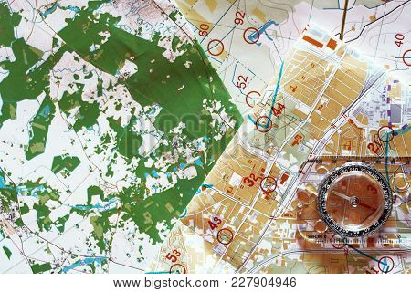 Top View Of Colorful Topographic Map For Orienteering Or Rogaining Sport And Compass. Concept Of Ore