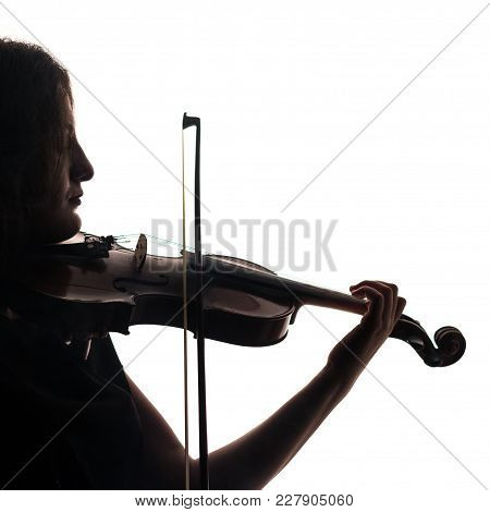 Silhouette Of A Woman Violinist. Violin And Bow In Musical Hands. Square. Close-up.