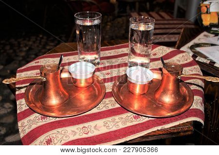 Turkish Coffee And Turkish Delights. Cup Of Arabic Coffee And Glass Of Cold Water. Traditional Turki