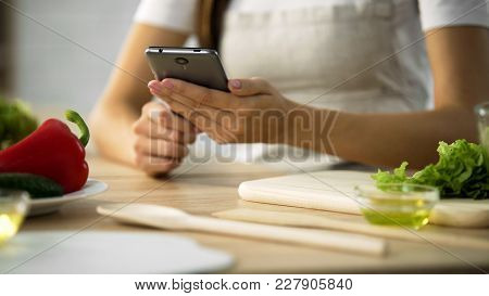 Close-up Of Female Hands Scrolling On Smartphone, Woman Choosing Salad Recipe, Stock Footage
