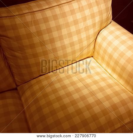 Checked Armchair In Spotlight. Classic Style Comfortable Furniture.