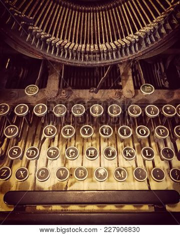 Keys Of An Old Rusty And Dusty Typewriter. Retro Style Photo.