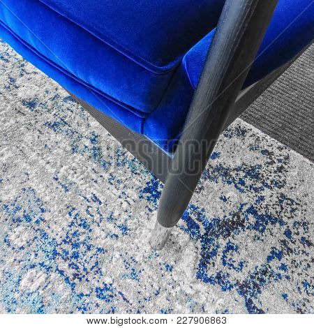 Close-up Of A Luxurious Blue Velvet Armchair On A Fashionable Rug. Classic Style Furniture.