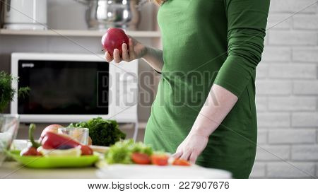 Hungry Female Holding Red Apple In Hand For Snack, Healthy Choice, Vitamins, Stock Footage