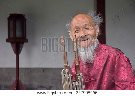 Beijing, China - Circa September 2016:  An Old Man With Flute, Traditional Chinese Music Instrument.