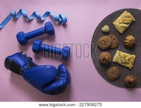 On A Pink Background Dumbbells Blue And Flying Centimeter Figure Sport Box Glove Soft Light Against
