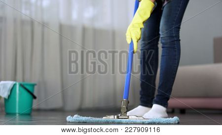Housewife Carefully Washing Floor In Her Apartment With Mop, Spring-cleaning, Stock Footage
