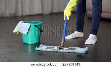 Obsessive With Cleanliness Young Lady Thoroughly Washing Floor Of Her House, Stock Footage