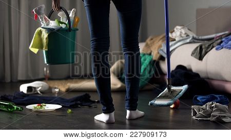 Shocked Cleaning Lady Standing In Messy Hotel Room With Mop And Washing Bucket, Stock Footage
