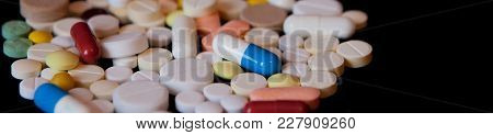 Pharmacy Background On A Dark Table. Levitation Pills. Tablets On A Dark Background Which Falling Do