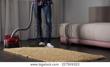 Female Maid Hoovering Carpet Near Sofa In Living Room, House Chores, Freshness, Stock Footage