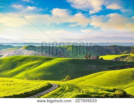 Tuscany, Rural Sunset Landscape. Countryside Farm, Cypresses Trees, Green Field, Sun Light And Cloud